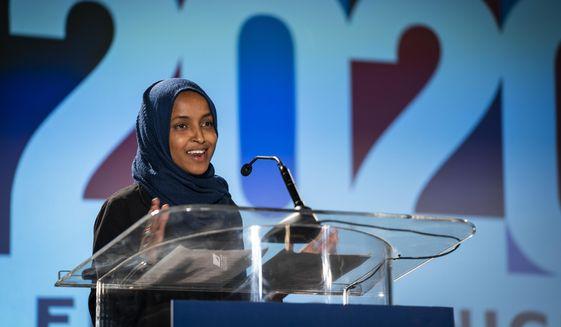 U.S. Rep. Ilhan Omar, D-Minn., speaks to the media during an election night watch party in St. Paul, Minn., Tuesday, Nov. 3, 2020. (Leila Navidi/Star Tribune via AP) ** FILE **