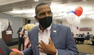 Burgess Owens, a Republican candidate in Utah's 4th Congressional District, speaks with people during a Utah Republican election night party Tuesday, Nov. 3, 2020, in Sandy, Utah. (AP Photo/Rick Bowmer)