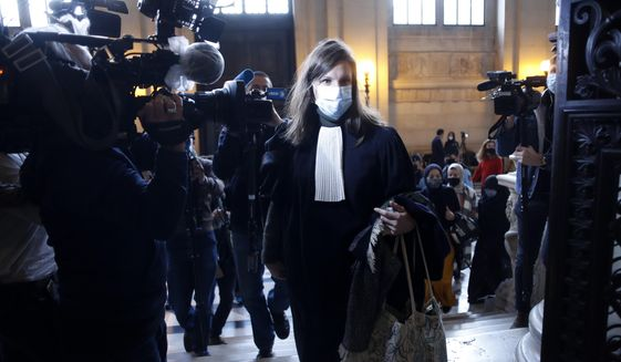 Lawyer of Islamic State operative Ayoub El Khazzaniin, Sarah Mauger-Poliak, arrives on the opening day of the Thalys attack trial, at the Paris courthouse, Monday, Nov. 16, 2020. El Khazzani goes on trial Monday Nov. 16, 2020, in France on terror charges for appearing on a train with an arsenal of weapons and shooting one passenger in 2015. (AP Photo/Thibault Camus)