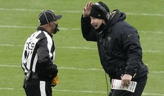 Jacksonville Jaguars head coach Doug Marrone argues a call with side judge Dyrol Prioleau (109) during the second half of an NFL football game against the Green Bay Packers Sunday, Nov. 15, 2020, in Green Bay, Wis. The Packers won 24-20. (AP Photo/Morry Gash)