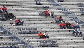 Louisville fans sit socially distant during an NCAA college football game Saturday, Nov. 14, 2020, in Charlottesville, Va. (Erin Edgerton/The Daily Progress via AP)