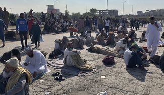 Supporters of 'Tehreek-e-Labaik Pakistan, a religious political party, take a rest while blocking a main road during an anti-France rally in Islamabad, Pakistan, Monday, Nov. 16, 2020. The supporters are protesting the French President Emmanuel Macron over his recent statements and the republishing in France of caricatures of the Muslim Prophet Muhammad they deem blasphemous. (AP Photo/Anjum Naveed)
