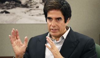 """FILE - In this April 24, 2018, file photo, illusionist David Copperfield appears in court in Las Vegas. Copperfield is suspending his Las Vegas stage show in the wake of a crew member testing positive for COVID-19. The Las Vegas Review Journal reported Monday, Nov. 16, 2020, that the legendary magician has """"no idea yet"""" when his production at MGM Grand will resume. (AP Photo/John Locher, File)"""