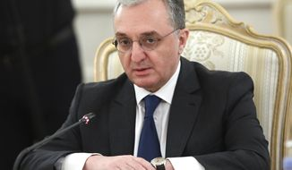 FILE - In this file photo released by Russian Foreign Ministry Press Service, Armenia's Foreign Minister Zohrab Mnatsakanyan attends a meeting with Russian Foreign Minister Sergei Lavrov in Moscow, Russia. Armenia's foreign minister resigned on Monday, Nov. 16, 2020 amid political turmoil that has engulfed the country following a cease-fire deal over the separatist region of Nagorno-Karabakh that called for territorial concessions. The resignation of Zohrab Mnatsakanyan may indicate that the political crisis in Armenia is deepening. (Russian Foreign Ministry Press Service via AP, File)