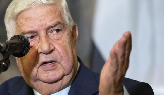 In this Aug. 30, 2018, file photo, Syrian Foreign Minister Walid al-Moallem gestures as he speaks to the media in Moscow, Russia. Al-Moallem, a career diplomat who became one of the country's most prominent faces to the outside world during the uprising against Syria's President Bashar Assad, died Monday, Nov. 16, 2020. He was 79. (AP Photo/Alexander Zemlianichenko, File)