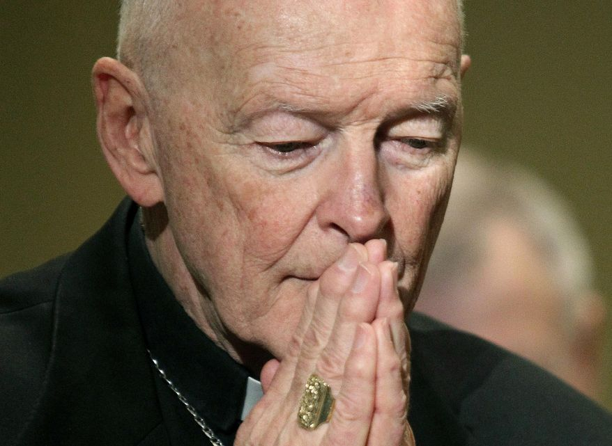 FILE - In this Nov. 14, 2011, file photo, then-Cardinal Theodore McCarrick prays during the United States Conference of Catholic Bishops' annual fall assembly in Baltimore. U.S. Catholic bishops are holding their annual fall assembly virtually this week with the Vatican's recent report on the rise and fall of disgraced ex-Cardinal McCarrick one of their main topics for discussion.  Released last week after a two-year investigation, the report found that three decades of bishops, cardinals, and popes dismissed or downplayed reports McCarrick shared his bed with seminarians.  (AP Photo/Patrick Semansky, File)