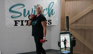 D' Lee Daleo rehearses an exercise routine before doing a live video exercise class at the Switch Fitness center in Elk Grove, Calif., Monday, Nov. 16, 2020. Daleo who is co-owner of Switch Fitness was critical of California Gov. Gavin Newsom's attendance at a birthday party that broke the very rules he has been preaching to slow the spread of the coronavirus. Newsom apologized for attending the party, Nov. 6 with a dozen friends at the pricy French Laundry restaurant in Napa.(AP Photo/Rich Pedroncelli)