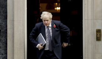 "FILE - In this Nov. 10, 2020 file photo British Prime Minister Boris Johnson leaves 10 Downing Street in London. Johnson is self-isolating after being told he came into contact with someone who tested positive for the coronavirus, officials said Sunday Nov. 15. ""He will carry on working from Downing Street, including on leading the government's response to the coronavirus pandemic,"" a statement from his office said. (AP Photo/Matt Dunham, File)"