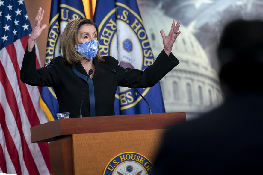 Speaker of the House Nancy Pelosi, D-Calif., meets with reporters on Capitol Hill in Washington, Friday, Nov. 13, 2020. (AP Photo/J. Scott Applewhite) **FILE**