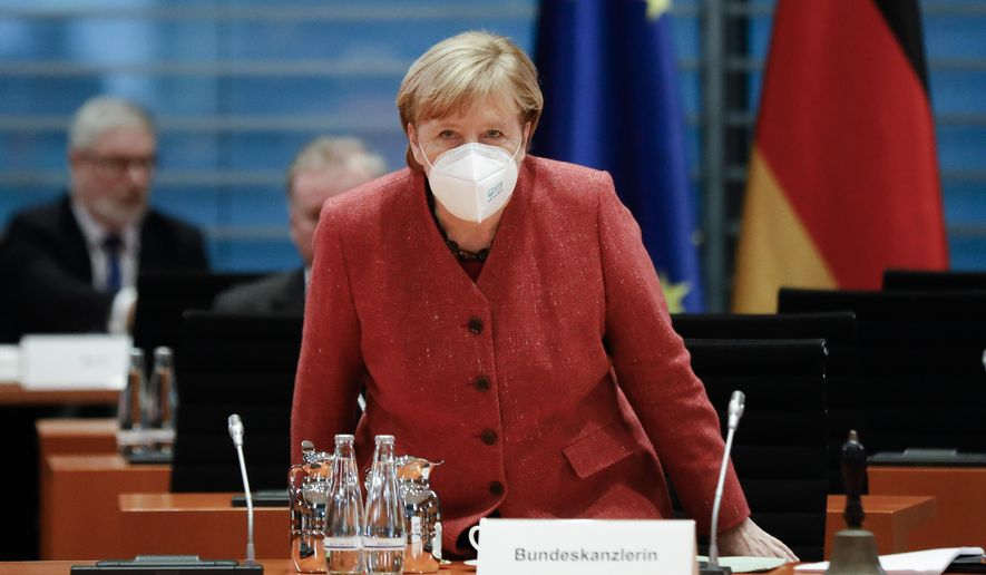 German Chancellor Angela Merkel arrives at the weekly cabinet meeting of the German government at the chancellery in Berlin, Germany, Wednesday, Nov. 11, 2020. (AP Photo/Markus Schreiber, pool)