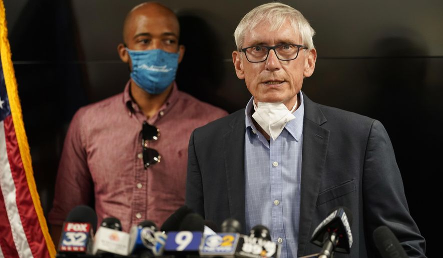 FILE - In this Aug. 27, 2020 file photo, Wisconsin Gov. Tony Evers speaks during a news conference in Kenosha, Wis. The Wisconsin Supreme Court was hearing arguments Monday, Nov. 16, on whether to strike down the state's mask mandate being challenged by conservatives as an unconstitutional overreach of power by Gov. Evers. (AP Photo/Morry Gash, File)
