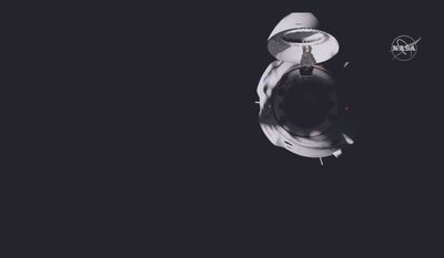 The SpaceX's Dragon capsule, dubbed Resilience, docked at 11:01 p.m. Eastern on Monday at the International Space Station. The astronauts will stay until April. (Associated Press Photographs)