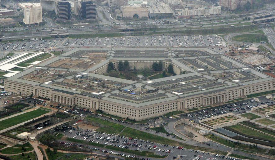 """This March 27, 2008 file photo shows the Pentagon in Washington. A new report by the conservative Heritage Foundation found U.S. military readiness for major conflict only """"marginal,"""" warning that the Pentagon was falling behind as adversaries China and Russia continue to improve their military capabilities. (AP Photo/Charles Dharapak, File)  *FILE**"""