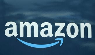 In this Oct. 1, 2020, file photo, an Amazon logo appears on an Amazon delivery van in Boston. Amazon opened an online pharmacy Tuesday, Nov. 17 giving shoppers the chance to buy their medication and order refills on their phones and computers and have it delivered to their doorsteps in a couple of days. (AP Photo/Steven Senne, File)
