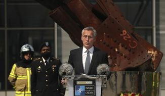 In this Friday, Sept. 11, 2020 file photo, NATO Secretary General Jens Stoltenberg speaks during a ceremony marking the 19th anniversary of the Sept. 11 attacks, at NATO headquarters in Brussels. (AP Photo/Francisco Seco, Pool, File)  **FILE**