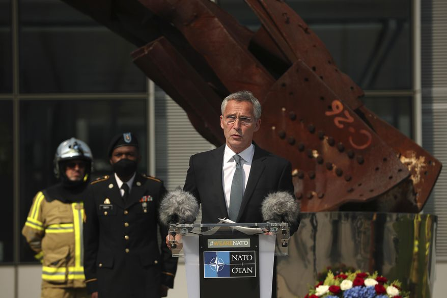 In this Friday, Sept. 11, 2020, file photo, NATO Secretary-General Jens Stoltenberg speaks during a ceremony marking the 19th anniversary of the Sept. 11 attacks, at NATO headquarters in Brussels. (AP Photo/Francisco Seco, Pool, File)  ** FILE **