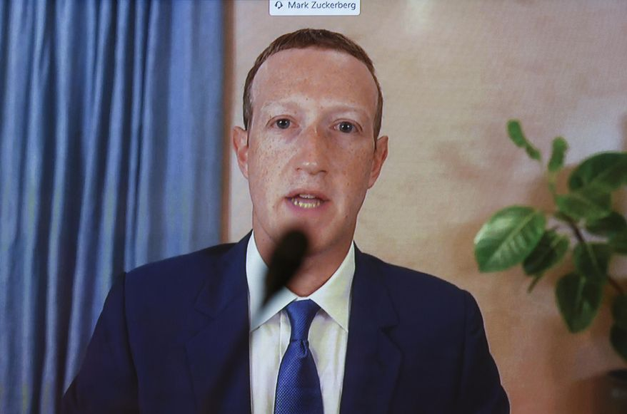 Facebook CEO Mark Zuckerberg testifies remotely during a Senate Judiciary Committee hearing on Facebook and Twitter's actions around the closely contested election on Tuesday, Nov. 17, 2020, in Washington. (Hannah McKay/Pool via AP) ** FILE **