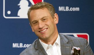FILE - In this Dec. 7, 2016, file photo, Chicago Cubs general manager Jed Hoyer smiles during a press conference in Oxon Hill, Md. Theo Epstein, who transformed the long-suffering Chicago Cubs and helped bring home a drought-busting championship in 2016, is stepping down after nine seasons as the club's president of baseball operations.The team announced Monday, Nov. 16, 2020, Epstein is leaving the organization, and general manager Jed Hoyer is being promoted to take his place. (AP Photo/Cliff Owen, File)
