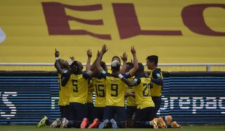 Ecuador's players celebrate after Roberto Arboleda scored his side's opening goal against Colombia during a qualifying soccer match for the FIFA World Cup Qatar 2022 in Quito, Ecuador, Tuesday, Nov. 17, 2020. (Rodrigo Buendia, Pool via AP)