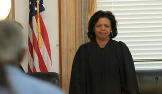FIEL - In this May 15, 2019 file photo, Chief Justice Cheri Beasley presides at a special session of the Supreme Court of North Carolina at New Bern City Hall in New Bern, N.C. Candidates in North Carolina's yet-decided races for Supreme Court chief justice and attorney general awaited final official results on Monday, Nov. 16, 2020, from several counties, two of which had to adjust previous tallies due to administrative errors.  Beasley and challenger Paul Newby, the senior associate justice, remained in an extremely close election. A statewide recount in the race was likely as hundreds of votes separated the two from nearly 5.4 million counted. (Gray Whitley/Sun Journal via AP, File)