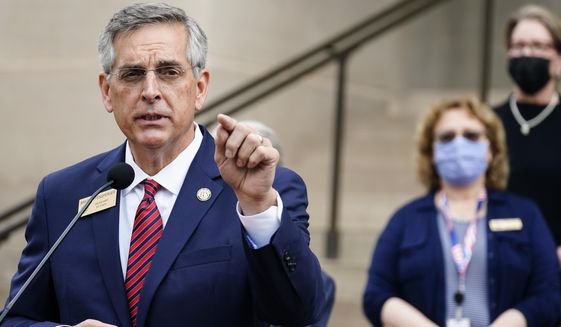 Georgia Secretary of State Brad Raffensperger speaks during a news conference on Wednesday, Nov. 11, 2020, in Atlanta. Georgia election officials have announced an audit of presidential election results that will trigger a full hand recount. (AP Photo/Brynn Anderson) **FILE**