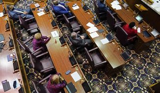 Members in the House of Representatives listen as Indiana House Speaker Todd Huston speaks during Organization Day at the Statehouse, Tuesday, Nov. 17, 2020, in Indianapolis. (AP Photo/Darron Cummings, pool)