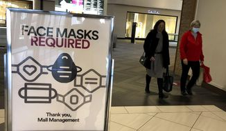 "In this  Nov. 13, 2020, file photo, a ""Face masks required"" sign is displayed at a shopping center in Schaumburg, Ill. (AP Photo/Nam Y. Huh, File) ** FILE **"