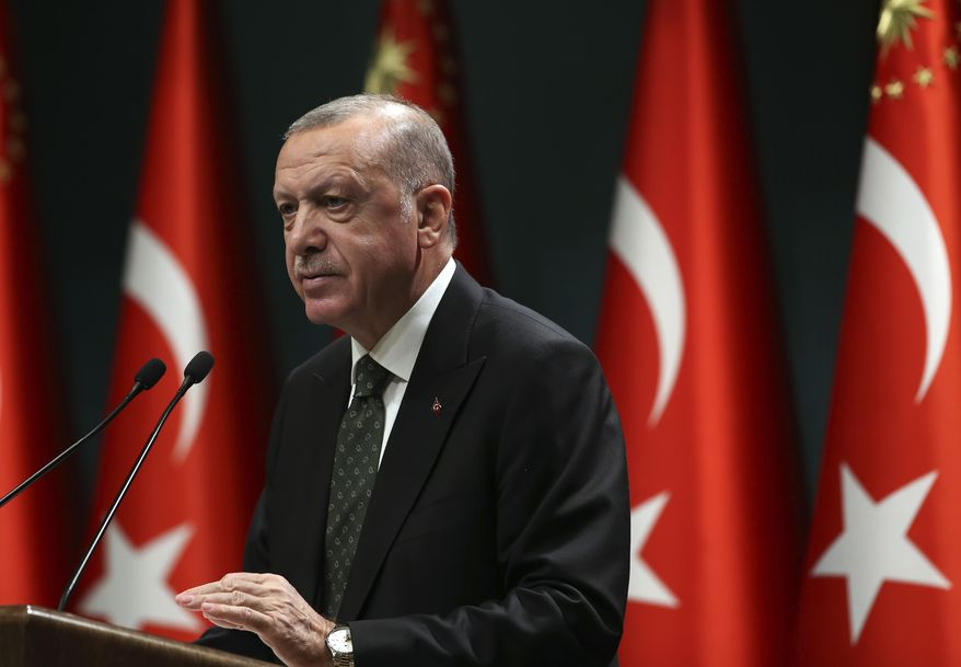 Turkey's President Recep Tayyip Erdogan speaks following a cabinet meeting in Ankara, Turkey, Tuesday, Nov. 17, 2020. Turkey is re-introducing a series of restrictions, including partial weekend lockdowns, in a bid to slow the surge of COVID-19 cases in the country. (Turkish Presidency via AP, Pool)