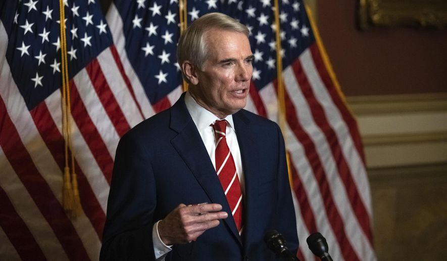 """FILE - This Monday, Oct. 26, 2020, file photo shows Sen. Rob Portman, R-Ohio, speaking during a news conference in Washington. Portman is participating in a COVID-19 vaccine study, hoping to encourage others to volunteer to take part in testing. Portman said in an interview that as much as he supports such precautions as masking and social distancing, vaccine development, distribution and use are the best hope for reducing the pandemic's toll, and he wanted to what he could to help """"explain the great potential for these vaccines"""" and the need for volunteers for trials. (Graeme Jennings/Pool Photo via AP, File)"""
