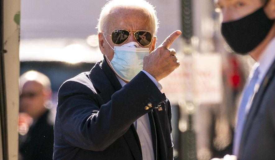 President-elect Joe Biden arrives at The Queen theater, Wednesday, Nov. 18, 2020, in Wilmington, Del. (AP Photo/Andrew Harnik)