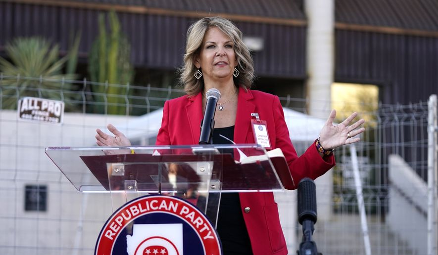 Dr. Kelli Ward, chair of the Arizona Republican Party, holds a press conference at the Maricopa County Elections Department as she reports the progress of the a post-election logic and accuracy test for the general election as an observer of the test process Wednesday, Nov. 18, 2020, in Phoenix. (AP Photo/Ross D. Franklin) ** FILE **