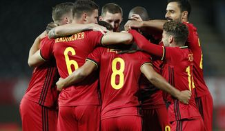 Belgium's Youri Tielemans, center back, celebrates after scoring the opening goal during the UEFA Nations League soccer match between Belgium and Denmark at the King Power stadium in Leuven, Belgium, Wednesday, Nov. 18, 2020. (AP Photo/Francisco Seco)
