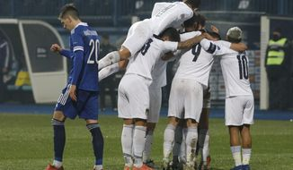 Italy players celebrate after Domenico Berardi scoried his side's second goal during the UEFA Nations League soccer match between Bosnia and Italy, in Sarajevo, Bosnia, Wednesday, Nov. 18, 2020. (AP Photo/Kemal Softic)