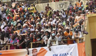 Supporters of Burkina Faso President Roch Kabore attend a campaign rally in Bobo-Dioulasso Thursday, Nov. 5, 2020. Burkina Faso will go to the polls on Nov. 22, 2020, to vote in presidential and legislative elections marred by ongoing violence. Attacks linked to Islamic militants have ravaged the once peaceful nation. (AP Photo/Sam Mednick)