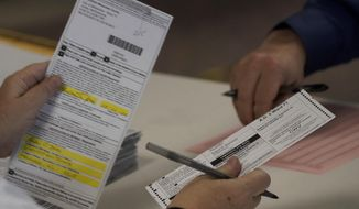 """FILE - In this Nov. 3, 2020 file photo, workers count Milwaukee County ballots on Election Day at Central Count in Milwaukee. President Donald Trump's campaign has paid $3 million for a recount of two heavily Democratic Wisconsin counties, saying Wednesday, Nov. 18, 2020, that they were the site of the """"worst irregularities"""" although no evidence of wrongdoing has been presented and state elections officials have said there was none. (AP Photo/Morry Gash File)"""