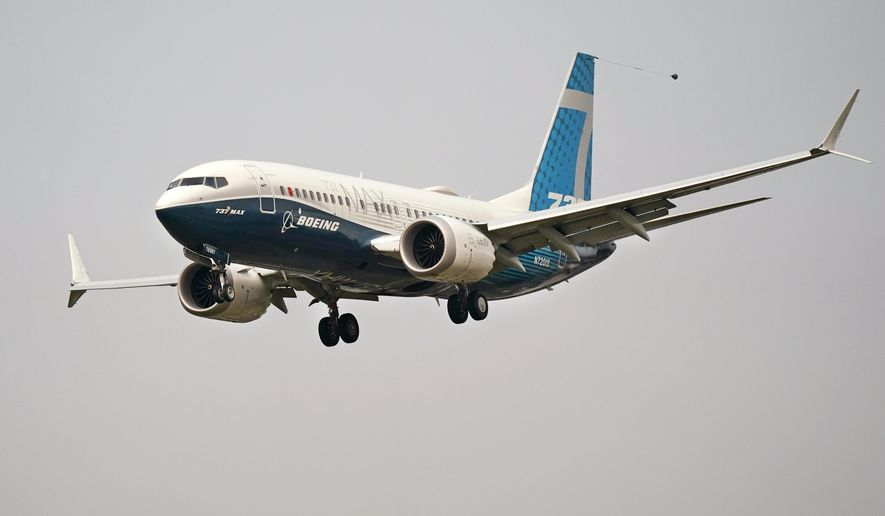 In this Wednesday, Sept. 30, 2020, photo, a Boeing 737 Max jet, piloted by Federal Aviation Administration Chief Steve Dickson, prepares to land at Boeing Field following a test flight in Seattle. The FAA is poised to clear the Boeing 737 Max to fly again after grounding the jets for nearly two years due to a pair of disastrous crashes that killed 346 people. (AP Photo/Elaine Thompson) **FILE**
