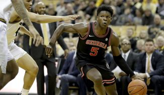 FILE - Georgia's Anthony Edwards heads to the basket during the first half of an NCAA college basketball game against Missouri in Columbia, Mo., in this Tuesday, Jan. 28, 2020, file photo. Edwards is expected to be one of the top picks in the NBA Draft on Wednesday, Nov. 18, 2020. (AP Photo/Jeff Roberson, FIlre)
