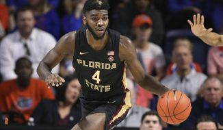FILE - In this Nov. 10, 2019, file photo, Florida State forward Patrick Williams brings the ball up during the first half of the team's NCAA college basketball game against Florida in Gainesville, Fla. Williams was selected by the Chicago Bull in the NBA draft Wednesday, Nov. 18. (AP Photo/Matt Stamey)