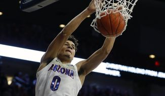 FILE - In this Wednesday, Dec. 11, 2019 file photo, Arizona guard Josh Green (0) dunks against Omaha in the second half during an NCAA college basketball game in Tucson, Ariz. The Dallas Mavericks drafted Arizona guard Josh Green with the 18th pick in the first round Wednesday night, Nov. 18, 2020 adding a backcourt mate for Luka Doncic  (AP Photo/Rick Scuteri, File)