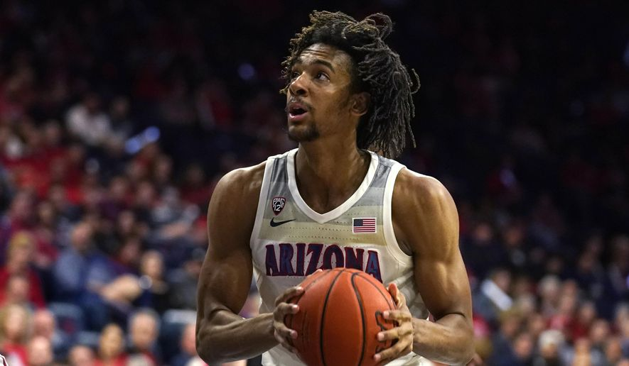 FILE - In this March 5, 2020, file photo, Arizona forward Zeke Nnaji looks to the basket during the second half of an NCAA college basketball game against Washington State in Tucson, Ariz. Nnaji was selected by the Denver Nuggets in the NBA draft Wednesday, Nov. 18, 2020. (AP Photo/Rick Scuteri)