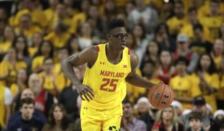 FILE - In this Dec. 7, 2019, file photo, Maryland forward Jalen Smith dribbles up court against Illinois during the second half of an NCAA college basketball game in College Park, Md. Smith was selected by the Phoenix Suns in the NBA draft Wednesday, Nov. 18, 2020. (AP Photo/Julio Cortez, File) **FILE**