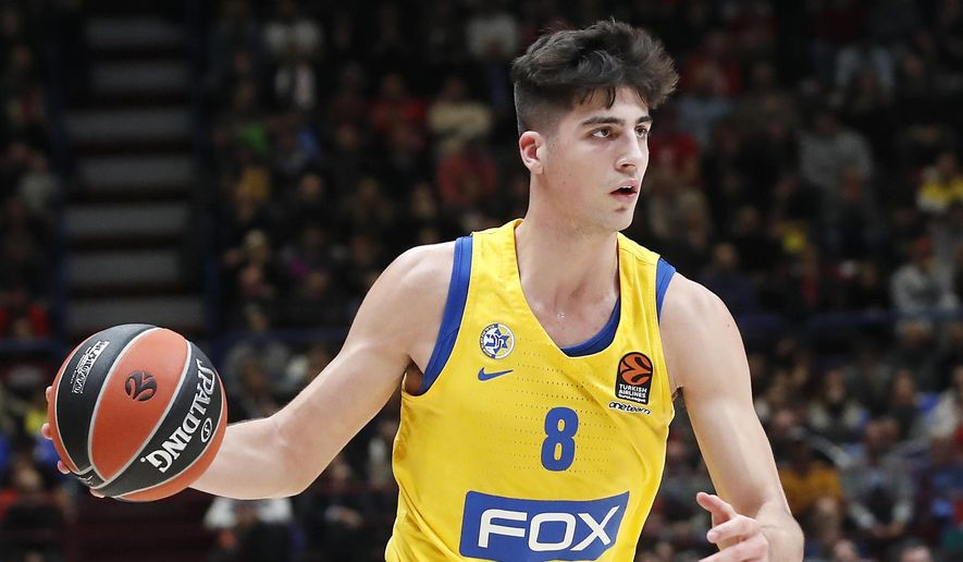 FILE - In this Nov. 19, 2019, file photo, Maccabi Fox Tel Aviv's Deni Avdija controls the ball during the Euro League basketball match between Olimpia Milan and Maccabi Fox Tel Aviv, in Milan, Italy. Avdija was selected by the Washington Wizards in the NBA draft Wednesday, Nov. 18, 2020. (AP Photo/Antonio Calanni, File)