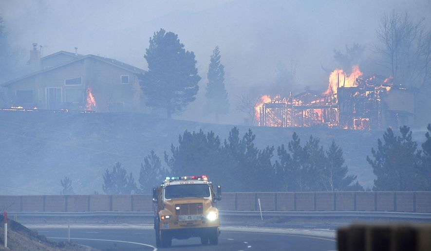 Firefighters battle the Pinehaven Fire in the Caughlin Ranch area of Reno, Nev., on Tuesday, Nov. 17, 2020. (Jason Bean/The Reno Gazette-Journal via AP)