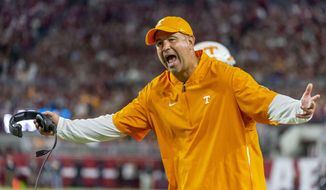 """FILE - In this Oct. 19, 2019, file photo, Tennessee head coach Jeremy Pruitt yells at the officials during an NCAA college football game against Alabama in Tuscaloosa, Ala. The SEC came into this season with a contingency plan to deal with coronavirus-related issues. """"Obviously, we can't predict the future,"""" Tennessee coach Jeremy Pruitt said. """"I believe we all knew when we started this, that there were no guarantees."""" (AP Photo/Vasha Hunt, File)"""