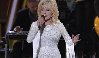 FILE - In this Nov. 13, 2019 file photo, Dolly Parton performs at the 53rd annual CMA Awards in Nashville, Tenn. Parton's $1 million gift to Nashville's Vanderbilt University helped researchers develop Moderna's experimental coronavirus vaccine, announced this week. (AP Photo/Mark J. Terrill, File)