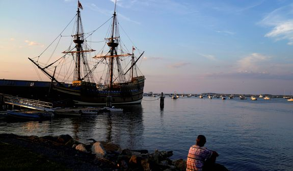 """The Mayflower II, a replica of the original Mayflower ship that brought the Pilgrims to America 400 year ago, is docked in Plymouth, Mass., days after returning home following extensive renovations, Wednesday, Aug. 12, 2020. A disease outbreak that wiped out large numbers of the Native inhabitants of what is now New England gave the Pilgrims a beachhead in the """"New World."""" So, some historians find it ironic that a pandemic has put many of the 400th anniversary commemorations of the Mayflower's landing on hold. (AP Photo/David Goldman)"""