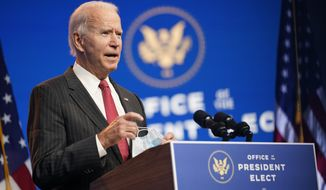 President-elect Joe Biden, accompanied by Vice President-elect Kamala Harris, speaks at The Queen theater, Thursday, Nov. 19, 2020, in Wilmington, Del. (AP Photo/Andrew Harnik)