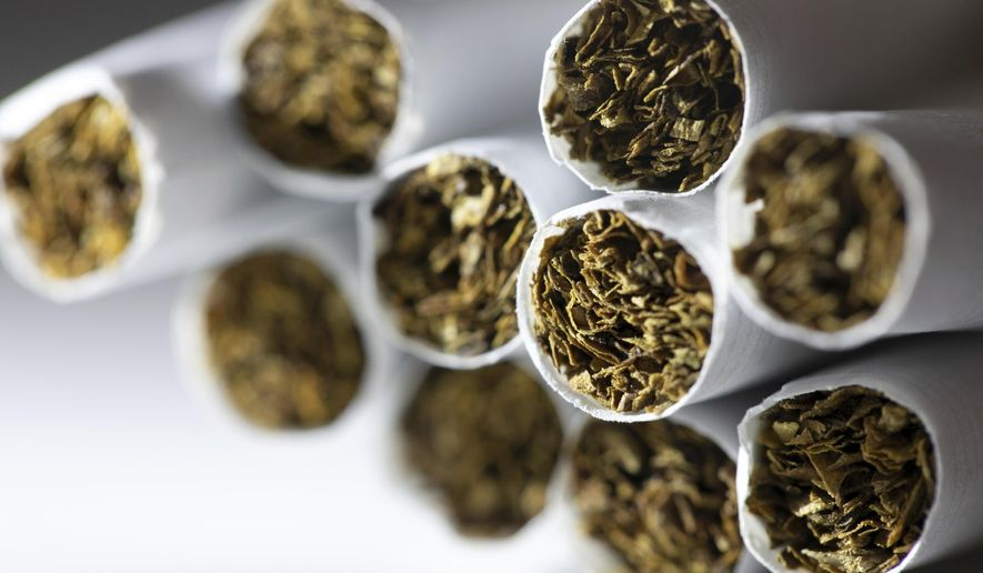 This Dec. 17, 2019, file photo shows a group of cigarettes in New York. (AP Photo/Patrick Sison) ** FILE **
