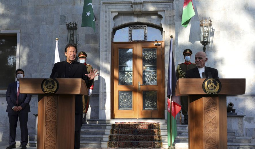 Pakistan Prime Minister Imran Khan, left, and Afghan President Ashraf Ghani attend a joint news conference at the Presidential Palace in Kabul, Afghanistan, Thursday, Nov. 19, 2020. Ghani on Thursday met with Khan in the capital Kabul to discuss Afghan peace talks, to build trust and strengthen relations between both Afghanistan and Pakistan. (AP Photo/Rahmat Gul)