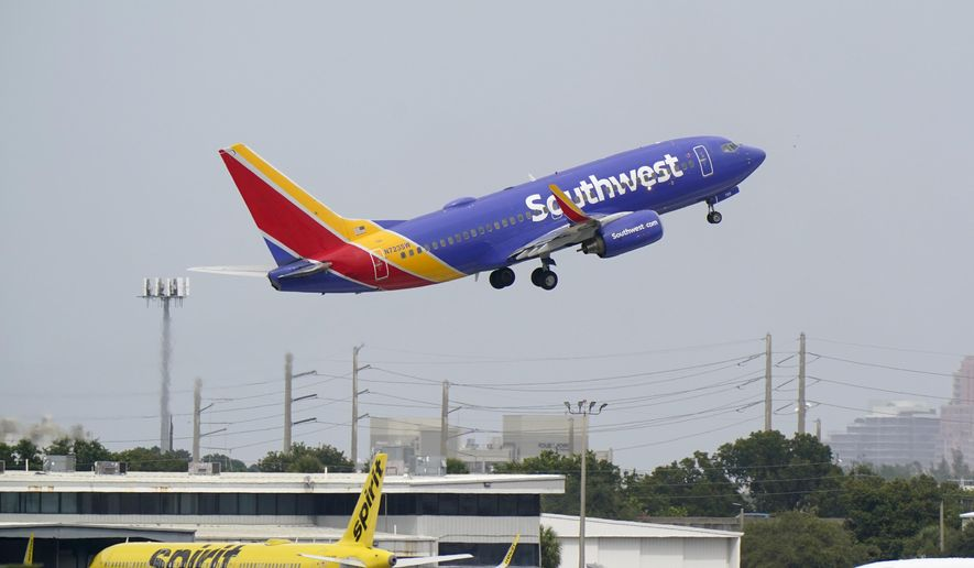 A Southwest Airlines Boeing 737-7H4 takes off from Fort Lauderdale-Hollywood International Airport in Fort Lauderdale, Florida, Oct. 20, 2020. (AP Photo/Wilfredo Lee) ** FILE **